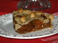 Learn how to make apple tart recipes. This recipe is made with dried apricots and dried apples. Filling is prepared in a saucepan. I used a 10 inch tart pan but you can use a 9 inch pie plate. You also need a crust for the bottom and the top. Tart baked for 35 to 40 minutes.