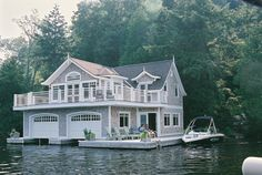 "Cute boathouse.  Not sure about the whole, ""hey, guys, let's hang out on the boat house dock,"" thing... but I love the garage doors and attention to architectural detail.  I'm guessing it doubles as a guest house on top (the bottom half holds boats and boat stuff).    http://www.michaelhatchdesigns.com/wp-content/uploads/2009/09/F1000023.JPG"