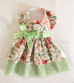 """Medium Minty Roses Dog Dress. It will fit a dog with a chest girth of 15 - 17"""". This dress is made from beautiful rose print fabric. The dress has a back length of 13.5"""". It velcros in the front of the neck and also underneath the belly. 