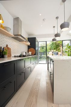 modern kitchen design with black cabinets and white subway tile, kitchen island . modern kitchen design with black cabinets and white subway tile, kitchen island design, open shelves in kitchen Kitchen Diner Extension, Open Plan Kitchen Diner, Open Plan Kitchen Living Room, Home Decor Kitchen, Kitchen Interior, Kitchen Ideas, Modern Kitchen Designs, Kitchen Splashback Ideas, Modern Farmhouse