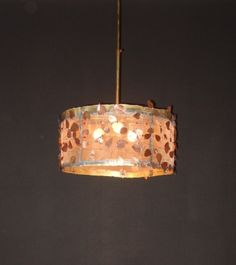 Handmade pendant lamp made of brass, copper and brass net.