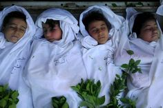 August 27, 2012  - ARTICLE - MASSACRE - CHILDREN - WAR CRIMES: REGIME - VICTIMS - Syrian troops murdered 320 people including women and children in the civil war's bloodiest massacre, rebels claimed yesterday.