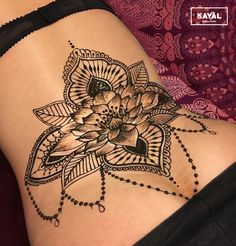 Water lily henna tattoo on the lower back by Ḵayāl henna studio. Instagram & Facebook: @kayalhennastudio