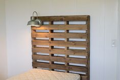 World's Easiest Pallet Headboard Would you look at that light! Love the vintage vibe, perfect for mitch's room :)