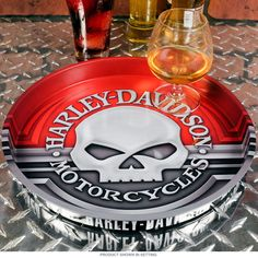 This Harley-Davidson Willie G. Skull serving tray helps refuel your guests with plenty of food and drink. It's made of heavy duty tin and features a classic skull design any motorcycle rider will love. A great addition to biker bars, man caves, and dream garages. Measures 12'' diameter x 1