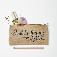 A lovely little case made from laminated jute and personalised with a classic typography font.Can be used as a pencil case but also could also be used to store lots of other bits and bobs.This pencil case comes in a natural colour with black print...