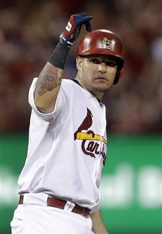Yadier Molina celebrates after hitting an RBI-double during the fourth inning of a baseball game against the Philadelphia Phillies.  Cards won the game 4-1. 7-23-13