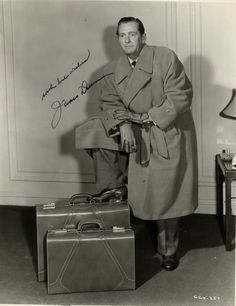 DUNN JAMES: (1901-1967) American Actor, Academy Award winner. Vintage signed 8 x 10 photograph of Dunn standing in a full length pose and resting one foot on a suitcase. Signed in bold, black fountain pen ink to a clear area of the image. Scarce.