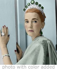 Edited to add color: Barbara Hutton wearing her Romanov Emerald Tiara, emerald earrings, and the 36 carat round Pasha diamond as a ring. Original B & W photo posted below.