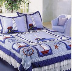 a handsome quilt for a man or boy's room.  Love the lighthouses and nautical theme