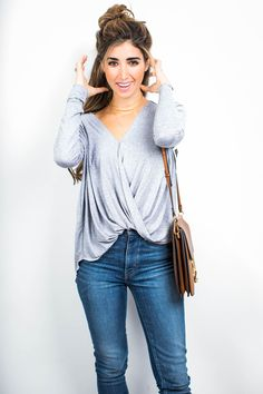 """The weather has been so hot, so cold, up and down, and back and forth again — it's definitely that """"I-don't-know-what-to-wear"""" kind of time. So when in doubt, reach for the wrap tee and a pair of classic jeans. If it's chilly, throw on your favorite bomber or overcoat; if it's warmer — roll up …"""