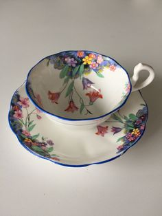 Early Royal Albert crown china tulip flowers with blue trim Teacup and Saucer