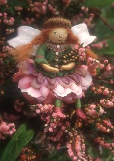Dying to make some of Salley Mavor's darling fairies out of bits of pipe cleaner, embroidery floss, wool felt, silk flowers and wooden beads.  Too sweet for any little girl (or girl-at-heart)
