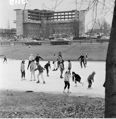 """People ice skating on the Duck Pond"" - To learn more, visit the Ball State University Campus Photographs in the Ball State University Digital Media Repository. Copyright 2013, Ball State University. All rights reserved."