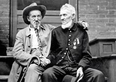 Confederate and Union Veteran Soldiers burying the hatchet between them 1913. [2048  1450]