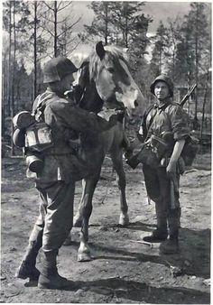 "Gebirgsjäger of the 6. SS ""Nord"" tending their pack horse."