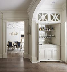 Built in bar with cabinet detail .