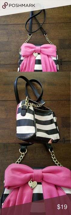 betsey johnson purse. Black and white betsey johnson purse.   Black and white striped large pick bow.  Super cute light wear on bottom and back as shown in picture.   Great inside and out Betsey Johnson Bags Shoulder Bags