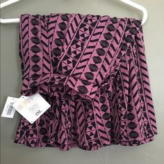 2XL LuLaRoe Madison Skirt, NWT This is a beautiful, brand-new LuLaRoe Madison skirt in 2XL, a harder-to-find plus size. Never even tried on. The color is a pinky-purple with black pattern. LuLaRoe Skirts A-Line or Full