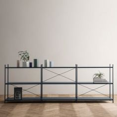 Ferm Living's furniture collection includes perforated shelves and stackable chairs