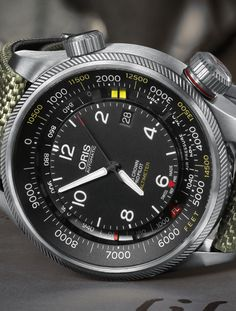 """Oris Big Crown ProPilot Altimeter Launch, Ambri Air-field, Switzerland. Oris has released a new timepiece, which is the world's first automatic mechanical watch with an altimeter. The Oris Big Crown ProPilot Altimeter watch has an outer scale for the altitude via the yellow indicator, while the """"recessed"""" scale is used to indicate the barometric pressure via the red indicator. More on https://www.facebook.com/photo.php?fbid=10152447417362900set=pcb.10152447419822900type=1theater"""