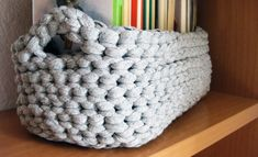 A functional way to store all your books using Tarn {T-shirt Yarn}. http://www.tarnsa.co.za/