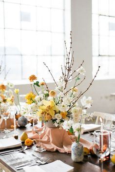 Yellow, oranges, peaches and whites for this centrepiece. Wedding Table Decorations, Wedding Table Settings, Wedding Table Numbers, Place Settings, Floral Centerpieces, Wedding Centerpieces, Floral Wedding, Wedding Flowers, Tall Floral Arrangements