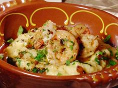 Bar Americain's Gulf Shrimp and Grits   I love this recipe - comfort food at its best!  The only thing I've changed is.....  I add chopped fresh jalapeno's to the grits.  Gives it a nice little kick but not overwhelming.