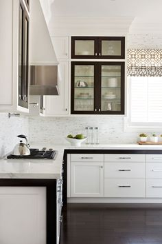 Chic espresso + white kitchen design by Gluckstein