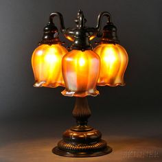 Tiffany Studios Three-light Table Lamp  Bronze, art glass  New York, early 20th century, base attributed to model 309