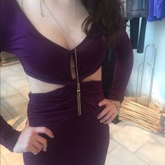 Dark plum dress with cut outs Love this dress ! It's a dark plum color and not to short . Never worn Dresses Mini