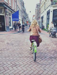 biking through amsterdam - europe travel bucket list!