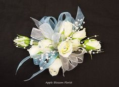 Wrist corsage, light & airy. Would love this general look for all the flowers. Instead of bouquets for the bridesmaids?