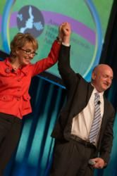 Gabrielle Giffords and husband Captain Mark Kelly honored with the American Speech-Language-Hearing Association's (ASHA's) Annie Glenn Award at the 2012 ASHA Convention at the Georgia World Congress Center in Atlanta on Nov. 16. Photo Credit: Ben Sledge/ASHA