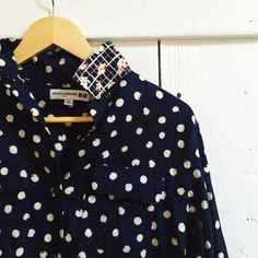 Uniqlo Ines de la Fressange button up shirt Navy with white polka dot flannel-like shirt. 100% cotton with a black/white/red floral print underneath the collar, sleeves, and chest pocket flaps. Worn once and in excellent condition. UNIQLO Tops Button Down Shirts