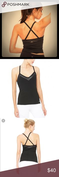 Alo yoga becka bra tank in black I've had this for awhile and it has just been hanging in my closet. Never worn new with tags. Alo yoga becka bra tank in black. Has removable padding, cute straps, and is so cute! Perfect for yoga, barre, Pilates, etc. ALO Yoga Tops Tank Tops