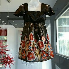 Beautiful floral print mini dress Fun and play floral mini dress. On trend with the 70's print we are seeing on the runways. Cap sleeves with lace trim details at edges. Around bust area is a satin material. The material on the lower part, is black with shimmery gold all over, floral print with an array of colors: orange, tan, brown, burgundry and blue.  New, never worn, tag attached Available in Size SMALL or MEDIUM (let me know which size you need) Tag says 100%cotton Dresses