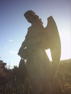 Angel statue on a grave stone in Llanfoist cemetary