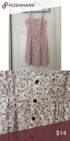 Tommy Hilfiger Floral Dress Adorable floral dress with buttons down the front and a drawstring waist. You can make this dress as loose or as cinched as you wish. Super cute with brown sandals! Tommy Hilfiger Dresses