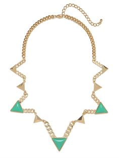 This lovely necklace gets a graphic upgrade with the addition of a zigzag pattern to classic curb links and high shine triad shaped gems for a look that makes a refined but singularly statement.