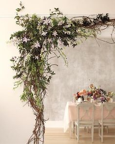 A Woodsy Welcome    Create an enchanting entrance to your reception with budding vines, like the clematis and grape- and passion vines shown here.
