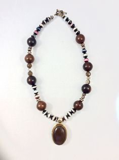 Sometimes the combination of beads just works! This is the perfect example. Gemstones, wood and a stunning focal pendant give this necklace a sophisticated tribal flair. So trendy!