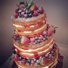 Naked Victoria sponge wedding cake decorated with fresh fruit.