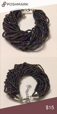 Multi strand purple metallic seed bead bracelet. Very elegant multi strand bracelet, made with purple metallic seed beads. Third picture is just to show you the difference between black seed bead and the purple one Jewelry Bracelets