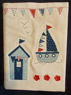Hand covered note book. Calico notebook cover beautifully decorated in a nautical theme with appliqued beach hut, boat and bunting . Clarke & Clarke fabric. Highlighted with buttons.100% cotton lining. This is complete with an A4 spiral bound notebook that can be replaced after use if required. Hand washable at a low temperature. Dry flat and can be ironed if necessary.  Price £9.99 + P  Paypal payment preferred - janice.bunting53@gmail.com