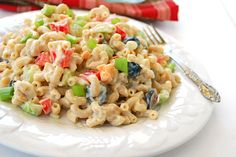 Vegan Macaroni Salad | Great for potlucks: I like the idea of loading it up with summer squash and tons of summer veggies, and I like the cubed daiya cheddar.