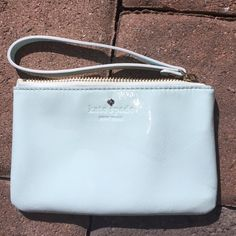 Kate Spade wristlet Kate Spade harrison street bee patent leather wristlet. Minor indents on front. Never used, I believe the marks are just from me storing it under other bags. Light blue color.  Offers accepted kate spade Bags