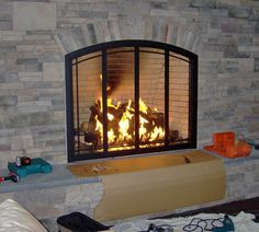 Improve the safety and efficiency of your fireplace by installing glass fireplace doors. Learn the benefits of glass fireplace doors and find a local UFS member hearth store to help with installation.