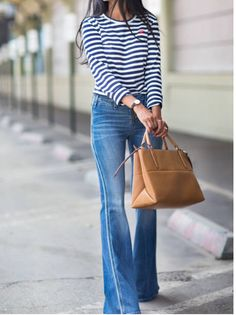 Ron Herman: The A Walk in Wonderland blogger is wearing Ron Herman soft denim flare jeans.