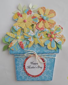 Mother's Day card. Spellbinder's flower creations die, Cricut walk in my garden flower pot, DCWV citrus paper collection. Top 2 flowers are attached to card that slides out.